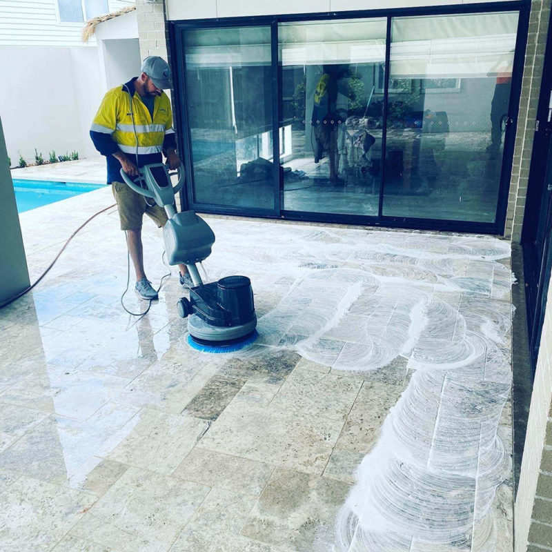 cleaning paver with machine
