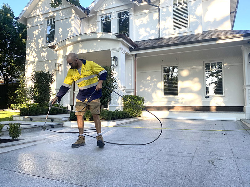 Our guy cleaning pavers